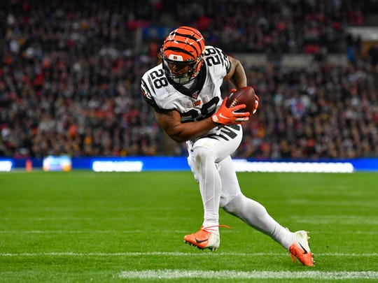 Oct 27, 2019; London, United Kingdom; Cincinnati Bengals running back Joe Mixon (28) catches a 1 yard pass for a touchdown during the second quarter of the game between the Los Angeles Rams and the Cincinnati Bengals during an NFL International Series game at Wembley Stadium. Mandatory Credit: Steve Flynn-USA TODAY Sports