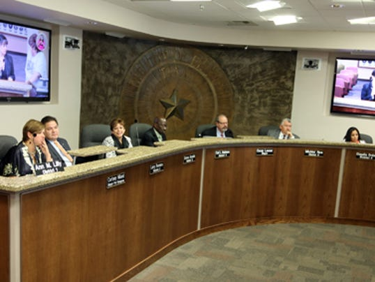 RUBEN R RAMIREZ EL PASO TIMES West Side city Rep. Ann Morgan Lilly said her request for a new computer and desk reconfiguration at another seating place during El Paso City Council meetings was deleted from today's agenda because it got resolved without the need for a debate on the matter. In this photo taken last week shows how Lilly sits next to City Rep. Courtney Niland, sharing one microphone.