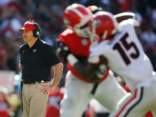 Georgia coach Kirby Smart watches during the second half of the NCAA college football team's spring game Saturday, April 16, 2016, in Athens, Ga. (AP Photo/John Bazemore)