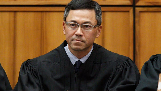U.S. District Judge Derrick Watson in Honolulu. Hours before it was to take effect, President Donald Trump's revised travel ban was put on hold Wednesday, March 15, 2017, by Watson, a federal judge in Hawaii who questioned whether the administration was motivated by national security concerns.