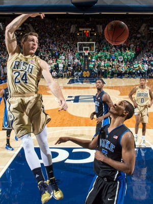 Notre Dame Fighting Irish guard Pat Connaughton (24) dunks over Duke Blue Devils forward Rodney Hood (5) in the second half at the Purcell Pavilion. Notre Dame won 79-77.