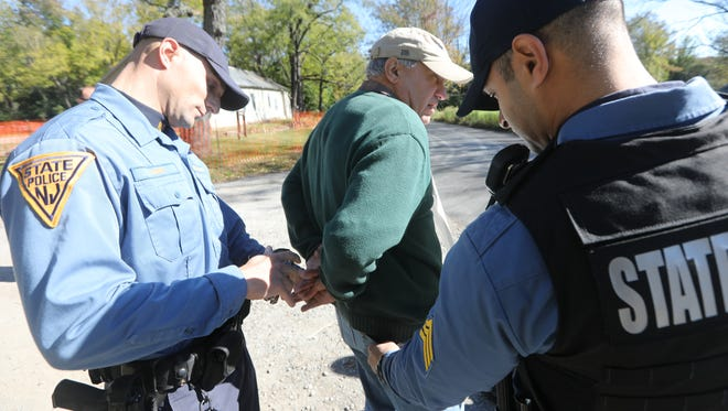 Bill Crain has been arrested eight times protesting New Jersey's state-sanctioned bear hunts, which Gov. Phil Murphy has pledged to end. Here, he is being taken into custody by state troopers in October 2016.