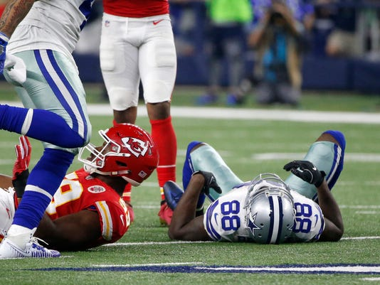 Dallas Cowboys' Dez Bryant (88) lays on the field by Kansas City Chiefs' Reggie Ragland (59) after attempting to catch a pass in the second half of an NFL football game on Sunday, Nov. 5, 2017, in Arlington, Texas. (AP Photo/Michael Ainsworth)
