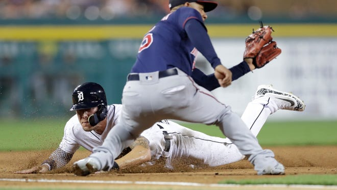 Tigers' JaCoby Jones slides into third base as Twins' Eduardo Escobar waits on the throw in the third inning Friday, Sept. 22, 2017 in Detroit.