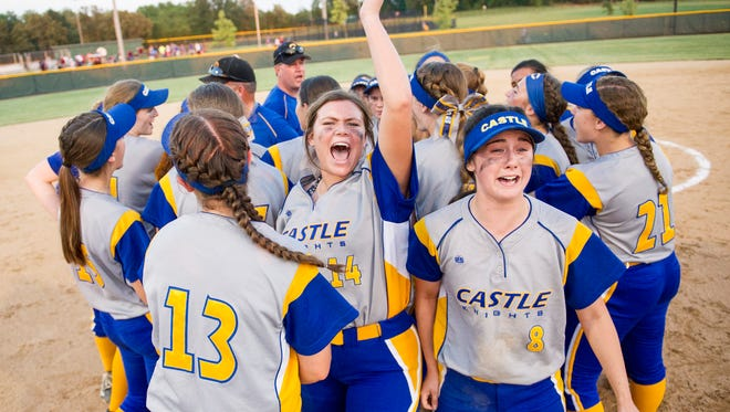 Castle players celebrate after defeating Gibson Southern in the Class 4A sectional final game on Saturday, May 26, 2018.