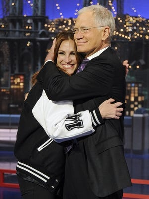 """Julia Roberts and David Letterman embrace during Wednesday's episode of """"Late Show."""""""