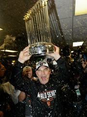 FILE - In this Oct. 29, 2014, file photo, San Francisco Giants manager Bruce Bochy celebrates after Game 7 of baseball's World Series against the Kansas City Royals, in Kansas City, Mo. Bochy says he will retire after this season, his 25th as a big league manager. Bochy says he told the team of his decision on Monday, Feb. 18, 2019. (AP Photo/David J. Phillip, File)