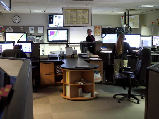 911 dispatch operators work at their stations Tuesday,