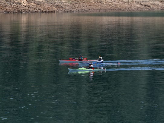 Kayakers make their way across Lake Shasta on Thursday