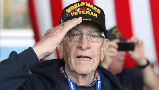 World War II veteran John Noonan of New Hempstead salutes at Westchester County Airport. The veterans were on their way to Washington, D.C., on a chartered flight as part of the 2014 Hudson Valley Honor Flight program.