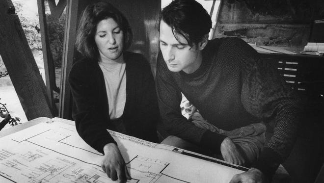 Taliesin West students Sharon Paty Monar and Ari Georges look at blueprints on Nov. 20, 1990.