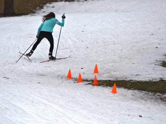 Cones mark an area to avoid on a small patch of snow