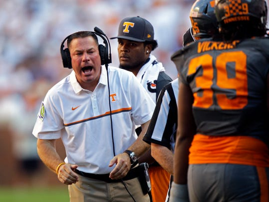 FILE - In this Sept. 24, 2016 file photo, Tennessee head coach Butch Jones yells to his players during an NCAA college football game against Florida in Knoxville, Tenn. Tennessee won 38-28. Jones has overhauled his coaching staff as the Volunteers get ready for a season in which they must find a new starting quarterback and replace their all-time sack leader. (AP Photo/Wade Payne, File)
