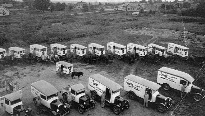 A circa 1935 photograph shows the transition between horse-drawn milk wagons and motorized vehicles at Quality Dairy of St. Cloud. The Rev. Ed Kraemer said he missed the horses when the dairy sold them.