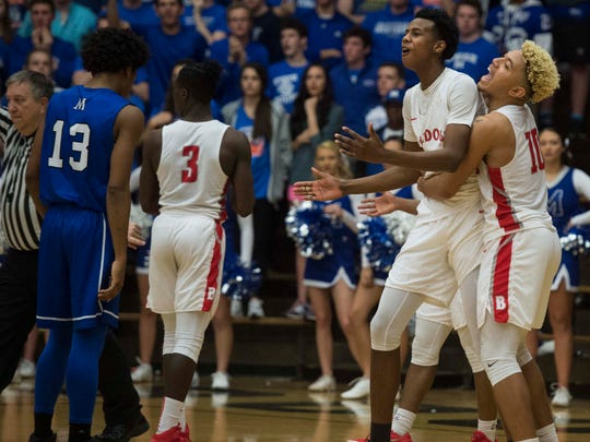 Bosse's Kiyron Powell (52) and Javen Layne (10) react to a last second foul call during the Class 3A Boonville Sectional final at Boonville High School on Saturday, March 3, 2018. Bosse defeated Memorial 67-62.