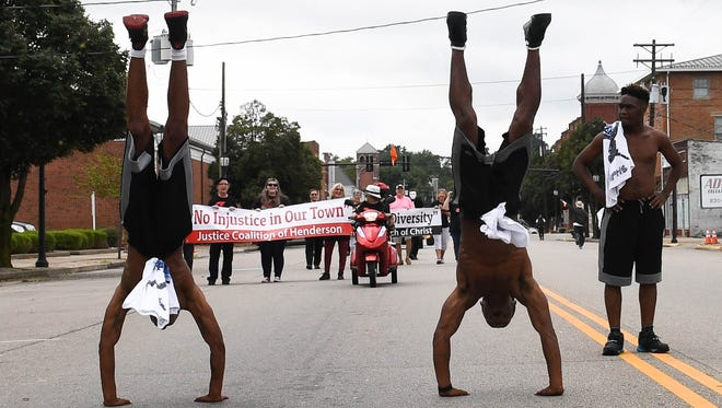 "Ricky Williams (left) and David Sims with the World Famous Beale Street Flippers do hand stands in the  ""Yes We Can"" Diversity Parade Saturday, September 17, 2016."