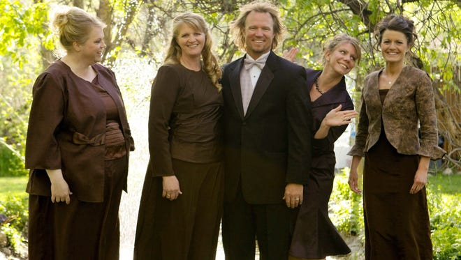 Kody Brown with his wives, from left, Janelle, Christine, Meri, and Robyn in a photo for TLC's reality TV show, 'Sister Wives.'