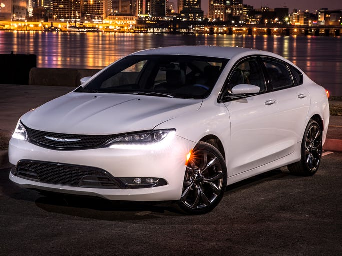 More cars are ditching traditional shift levers for their automatic transmissions to go to buttons and knobs. The 2015 Chrysler 200 sedan has a novel shift arrangement inside