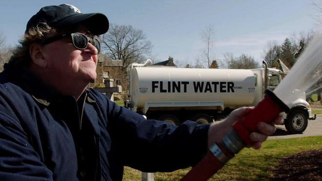 "Michael Moore shows up at Gov. Rick Snyder's home with a hose in ""Fahrenheit 11/9."""