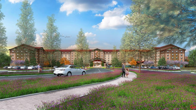 An artist's rendering of the front exterior of Great Wolf Lodge, which is scheduled to open in June.