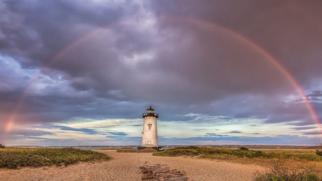 Edgartown Lighthouse is framed by a rainbow in this image from Martha's Vineyard photographer Michael Blanchard who credits his passion for photography with helping him to maintain his sobriety..   [MICHAEL BLANCHARD]  Edgartown Lighthouse is framed by a rainbow in this image from Martha's Vineyard photographer Michael Blanchard who credits his passion for photography with helping him to maintain his sobriety..