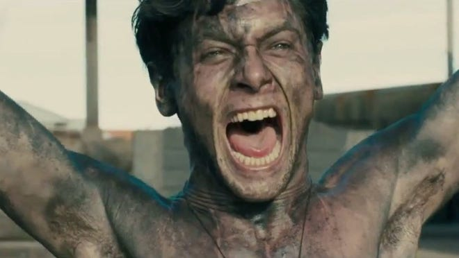 "Jack O'Connell as war hero Louis Zamperini in ""Unbroken."""