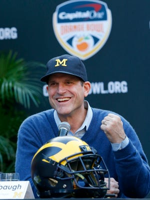 Michigan football coach Jim Harbaugh speaks during a news conference Wednesday, Dec. 7, 2016, in Hollywood, Fla.