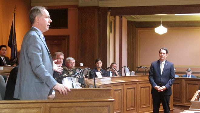 Assembly Speaker Robin Vos, left, asks Gov. Scott Walker questions after he spoke to Republican lawmakers on Thursday, Sept. 24, 2015, at the State Capitol in Madison. Walker told Republicans who control the state Assembly on Thursday that he is committed to making it easier to hire and fire state workers, saying the current system is broken.