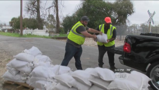 Sandbags are being distributed to residents in New Iberia.