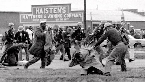 John Lewis (on ground) during attack on marchers in Selma, Ala., in 1965