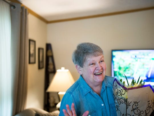 Dorothy 'Taffy' Spera reacts as she is surprised at her home Friday, May 18, 2018 in Williamstown, N.J. Spera was nominated as an 'Amazing Mom' by her daughter Cindy Zimmerman. Spera is a two-time breast cancer survivor, who was also the caregiver for her husband after a massive stroke left him paralyzed in 2003. He passed away in June.