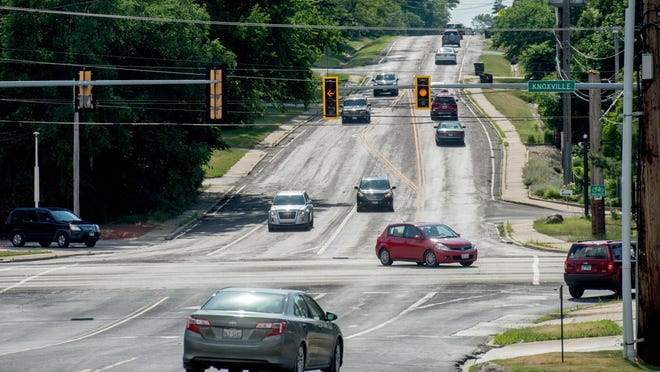 Traffic passes through the intersection of Knoxville and Lake on Thursday, July 9, 2020 in Peoria.