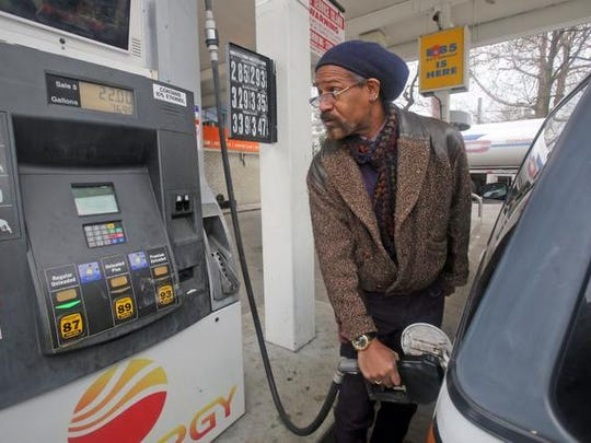 Charles Schofield of New Rochelle fills up his car at a gas station in New Rochelle Dec. 8, 2014, where the price of regular gas was $2.85 a gallon.