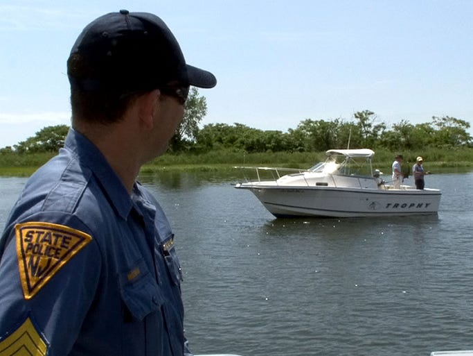 New Jersey State Police Staff Sergeant Chris Wozniak keeps an eye on boaters in the Shrewsbury River off Monmouth Beach Friday morning, June 27, 2014.  The State Police Marine Services Bureau will be out on the waterways checking for boating under the influence (BUI) and educating boaters about the dangers of BUI.