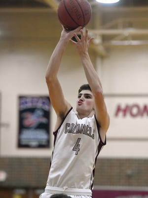 Rob Dawson of Henderson County takes a shot over of Daylan Lewis of Webster County during first quarter of the game at Henderson County High School in Henderson Tuesday.