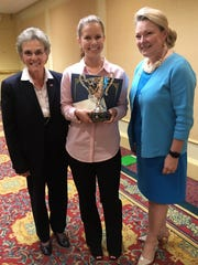 Mackenzie Pugh of Wakulla HSHT  with Dr. Susanne Homant, left, and Karen Moore.
