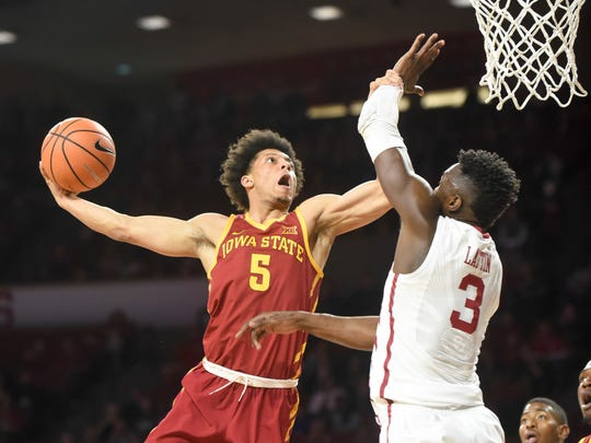 FILE - In this March 2, 2018, file photo, Iowa State's Lindell Wigginton, left, goes up to shoot over Oklahoma's Khadeem Lattin in the first half of an NCAA college basketball game, in Norman, Okla. Iowa State lost its last seven games in 2017-18 in part because it didn't have enough players to compete in the Big 12. Fourth-year coach Steve Prohm might have too many guys this season _ and how he manages a suddenly-stacked roster will determine if the Cyclones can get back to the NCAA Tournament after a one-year absence. (AP Photo/Kyle Phillips, File)