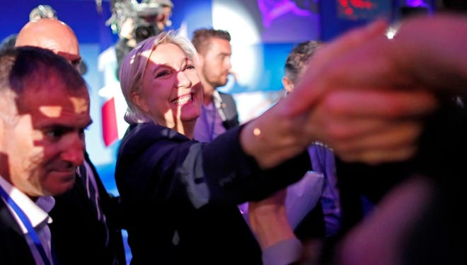 French presidential election candidate for the far-right Front National (FN) party, Marine Le Pen, greets supporters in Henin-Beaumont, Northern France, on April 23.