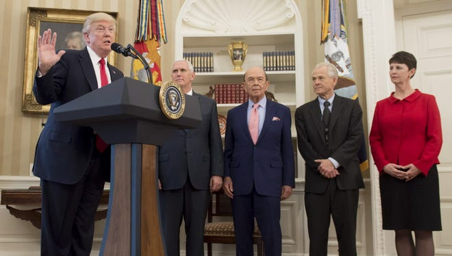 Peter Navarro, second from right, listens March 31,  2017, as President Donald Trump talks about trade policies in the Oval Office with Vice President Mike Pence (second left) and Commerce Secretary Wilbur Ross (center).