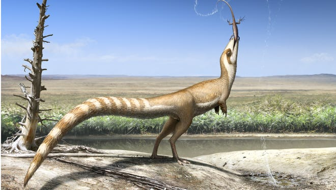 Artist's conception of the Sinosauropteryx dinosaur eating its prey in the open habitat in which it lived 130 million years ago in the early Cretaceous.