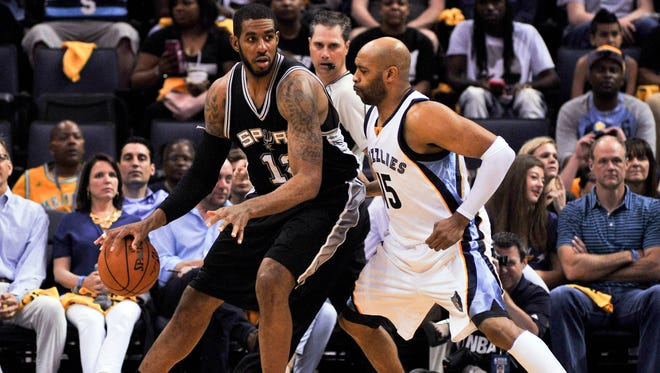 San Antonio Spurs forward LaMarcus Aldridge (12) posts up against Memphis Grizzlies guard Vince Carter (15) as the Spurs swept the first round series.
