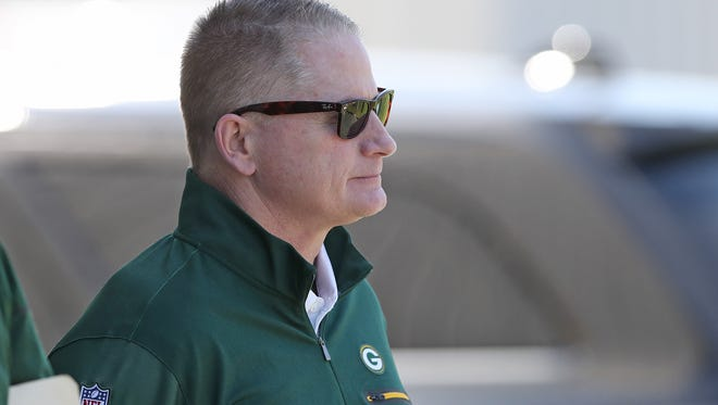 Packers vice president of football administration/player finance Russ Ball watches an OTA session June 1, 2017.