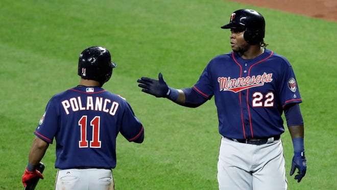 Minnesota Twins' Miguel Sano, right, high-fives teammate Jorge Polanco after scoring on a sacrifice fly ball that was hit by Eduardo Escobar in the fifth inning of a baseball game against the Baltimore Orioles in Baltimore, Monday, May 22, 2017.