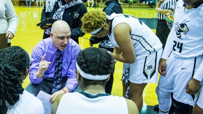 Advertiser photo by Buddy Delahoussaye-- New Iberia senior high head basketball coach Jeremy Bonin talks to his team during a time out on Thursday Feb. 25, 2016.