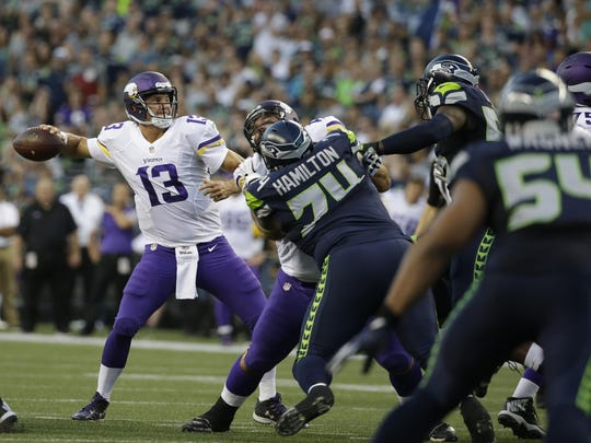Minnesota Vikings quarterback Shaun Hill (13) passes against the Seattle Seahawks in the first half of a preseason game on Aug. 18 in Seattle.