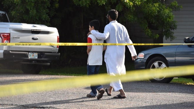 Mosque officials arrive at the Islamic Center of Fort Pierce after an overnight fire.