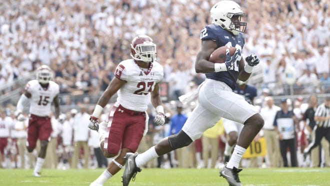 Penn State's Chris Godwin scores a touchdown after a 52-yard pass from quarterback Trace McSorley during the first quarter of Saturday's game against Temple at Beaver Stadium.