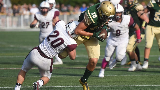 St. Joseph's Matthew Alaimo (10) being tackled by Don Bosco's Jason Haber.