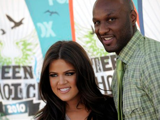 Khloe Kardashian and Lamar Odom arrive at the Teen Choice Awards on Sunday, Aug. 8, 2010 in Universal City, Calif. (AP Photos/Chris Pizzello)