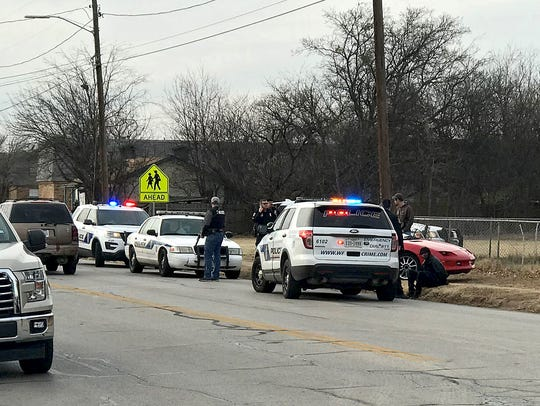Wichita Falls police work the scene of a single-vehicle